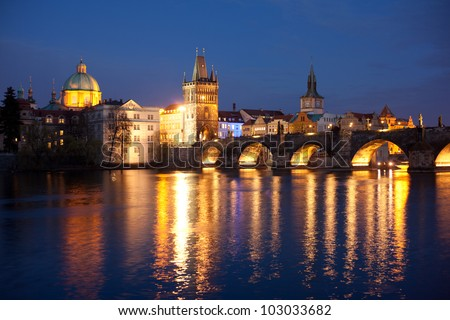 View of the Lesser Bridge Tower of Charles Bridge in Prague (Karluv Most) the Czech Republic. This bridge is the oldest in the city and a very popular tourist attraction - stock photo