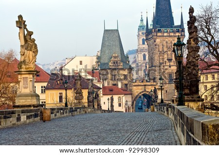 View of the Lesser Town Bridge Towers of Charles Bridge in Prague (Karlúv Most) the Czech Republic. This bridge is the oldest in the city and a very popular tourist attraction. - stock photo