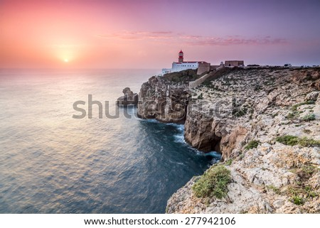 View of the lighthouse and cliffs at Cape St. Vincent at sunset. Continental Europe's most South-western point, Sagres, Algarve, Portugal. - stock photo