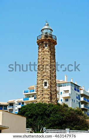 View of the lighthouse with apartments to the rear, Estepona, Malaga Province, Andalusia, Spain, Western Europe.