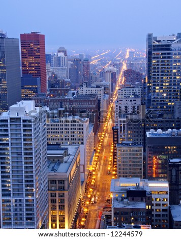 View of the lights of State Street in Chicago from the top of Marina Towers at night. - stock photo