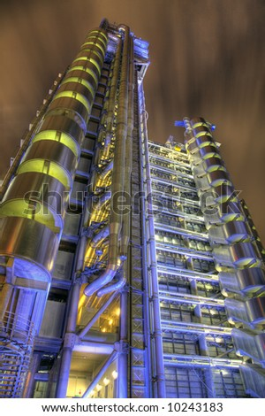 View of the Lloyds Building at One Lime Street in the City of London. Detailed night-time HDR image. - stock photo