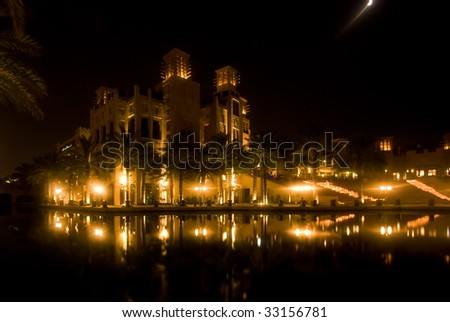 View of the Madinat Jumeihra at night - stock photo