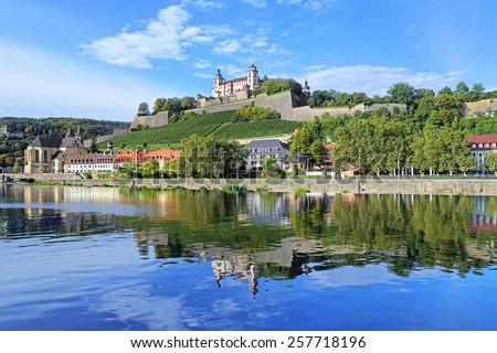 View of the Marienberg Fortress reflecting in the Main River in Wurzburg, Germany - stock photo