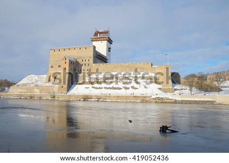 View of the medieval castle of Herman cloud March morning. Narva, Estonia