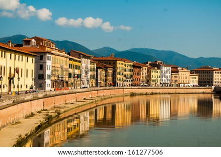 "View of the medieval town of Pisa from bridge ""Ponte di Mezzo"" on river Arno"