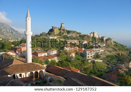 view of the minaret of the Kruja village and the Clock Tower and National Museum in Skanderbeg Castle, Albania - stock photo