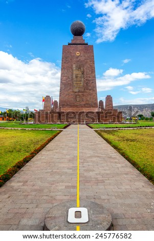 View of the Mitad del Mundo monument to the equator near Quito, Ecuador.  The yellow line divides the southern and northern hemispheres - stock photo