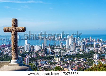 View of the modern part of Cartagena, Colombia with a stone cross in the foreground - stock photo