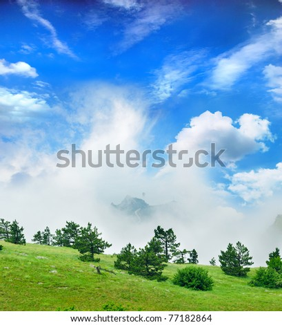 view of the mountain fog, path of the pioneer - stock photo