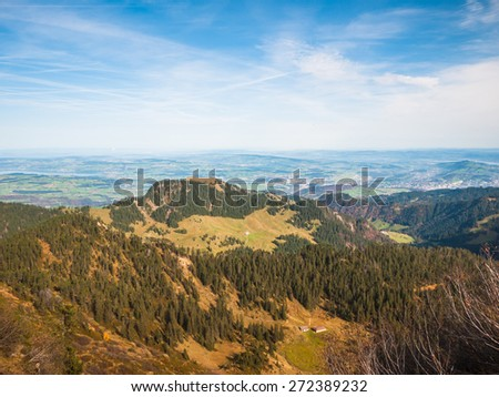 View of the mountain range on the hiking path towards Pilatus (a famous peak of swiss alps in Lucerne), above the Lucerne lake in Switzerland, with numerous peaks of the alps in background - stock photo