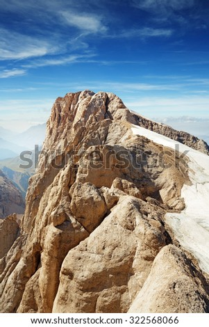 view of the mountaintop under a blue sky - stock photo