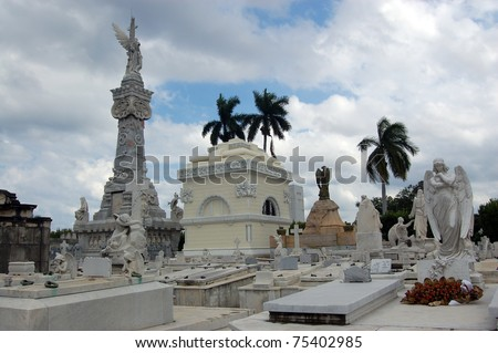 View of the Necropolis of Christobal Colon, Havana, Cuba.  The City's main cemetery has many historic monuments and memorials.  The tall pillar to the left  commemorates Havana's firefighters.