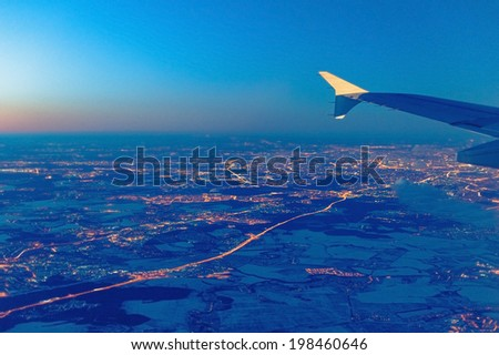 View of the night city from the airplane - stock photo