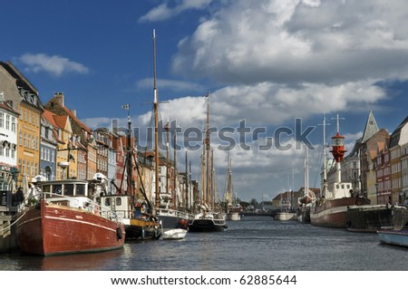 View of the Nyhavn district in Copenhage, Denmark in a sunny day 01 - stock photo