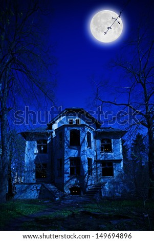 View of the old abandoned house at night - stock photo