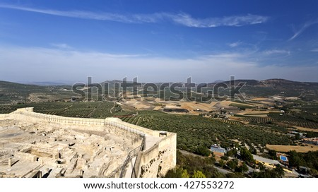 View of the olive groves surrounding the Fortaleza de La Mota and the city of Alcala la Real in Andalusia, Spain - stock photo