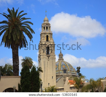 View of the ornate California Tower from the Alcazar Gardens in Balboa Park in San Diego with ornate dome - stock photo