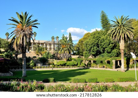 View of the parliament building, called the Tinten Palast or Ink Palace, in Windhoek, Namibia.  - stock photo
