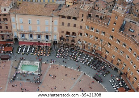 View of The Piazza del Campo from the Torre del Mangia - stock photo