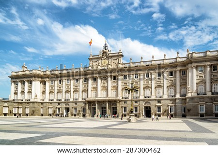 View of the Plaza de la Armeria (Armory Square) and the south facade of the Royal Palace of Madrid in Spain. Madrid is a popular tourist destination of Europe. - stock photo