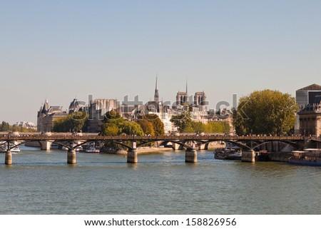 View of the Pont des Arts, Saint Louis island and Cite island over the Seine river, Paris, France - stock photo