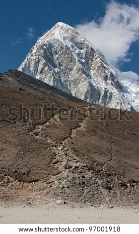 View of the Pumo Ri peak and Kala Patthar hill from Gorak Shep village- Mt. Everest region, Nepal