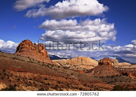 View of the red rock formations in Capitol Reef National Park with blue sky?s and clouds