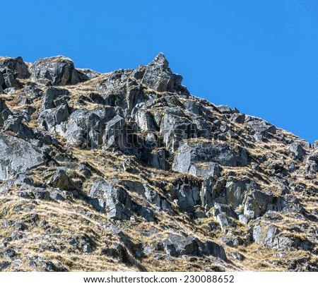 View of the rocky side of a mountain in the valley of the Dudh Koshi-Nadi - Everest region, Nepal, Himalayas - stock photo