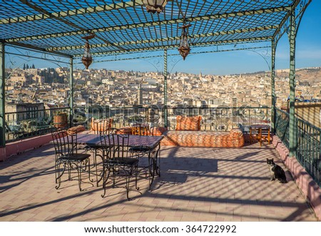 View of the rooftops of the Fez medina from a terrace iron arbour. Fez, Morocco. North Africa. - stock photo