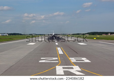 View of the runway with the airplane away - stock photo