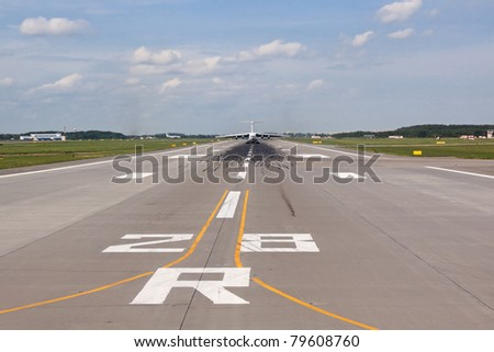 View of the runway with the plane away - stock photo