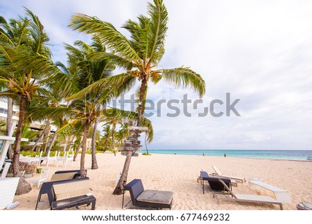 View of the sandy beach in Punta Cana, La Altagracia, Dominican Republic. Copy space for text