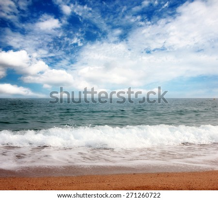 View of the sandy beach of the sea coast of Spain - stock photo
