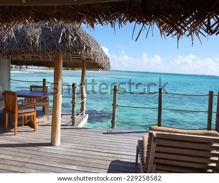 View of the sea from a wooden terrace over water. Maldives - stock photo