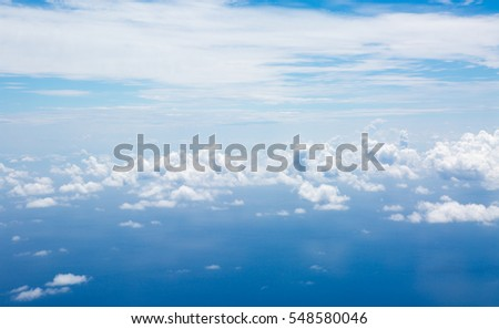 View of the sky and clouds from the airplane porthole