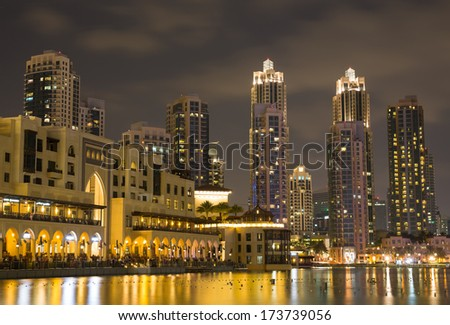 View of the skyscrapers of Dubai at night - stock photo