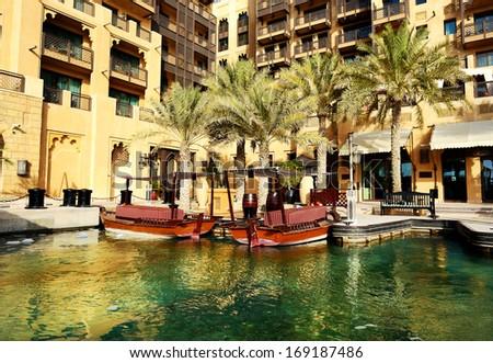 View of the Souk Madinat Jumeirah and abra boats, Dubai, UAE - stock photo