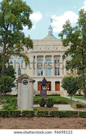 View of the south entrance to the Indiana State Capitol building in downtown Indianapolis showing monuments to the National Road and George Washington, vertical. - stock photo