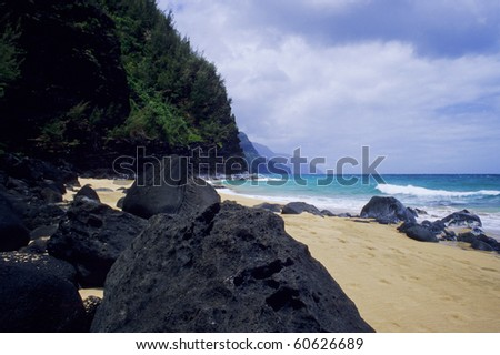 View of the spectacular Na Pali Coastline on the north side of Kauai, Hawaii. - stock photo