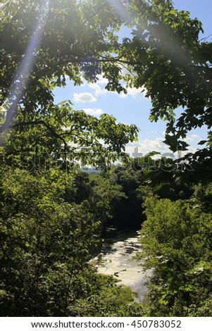 View of the spring from a tall bluff in a Missouri state park; camera flare - stock photo