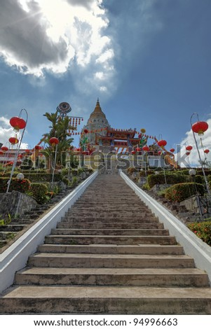 View of the stairway going up to the Kek Lok Si buddhist temple iconic pagoda in Air Itam, Penang, Malaysia. This is a HDR image. - stock photo