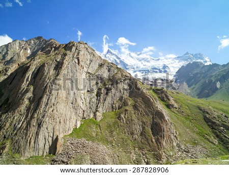 View of the steep cliffs and the glacier among snowy Himalayan peaks in Zanskar Valley in northern India - stock photo