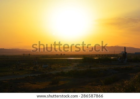 View of the sunset in an industrial area - stock photo