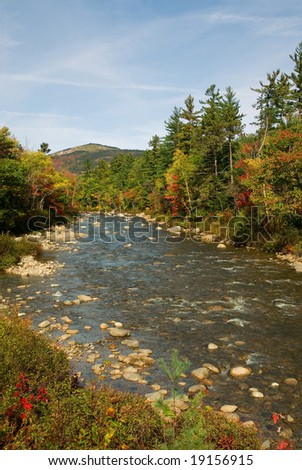 View of the Swift river from the Kancamagus Highway in New Hampsshire during peak autumn colors. - stock photo