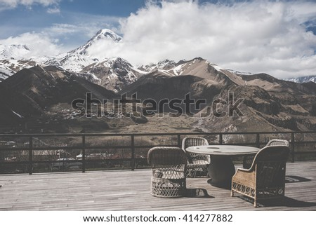 View of the terrace overlooking the Caucasus mountains and the mount Kazbek. Toned picture - stock photo