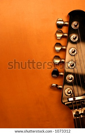 View of the top of a black electric guitar with copy-space - stock photo
