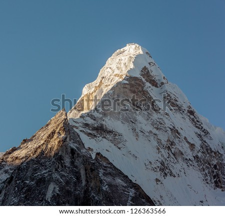 View of the top of the Ama Dablam (6814 m) from the valley of the Chhukhung - Nepal, Himalayas - stock photo