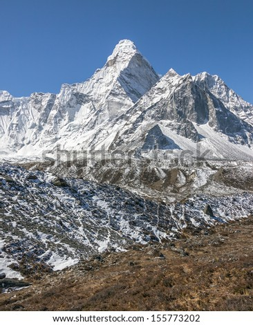 View of the top of the Ama Dablam (6814 m) from the valley of the Chhukhung (view from Chhukhung Ri) - Nepal, Himalayas - stock photo