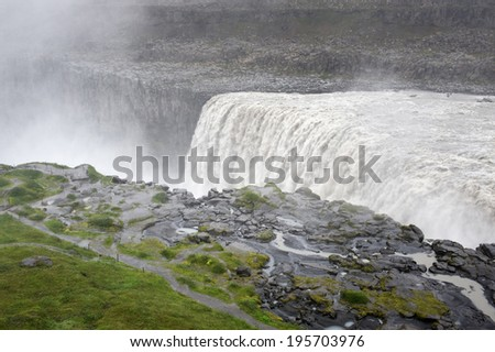 View of the tourist paths and Dettifoss waterfall from above on a cloudy day, Iceland